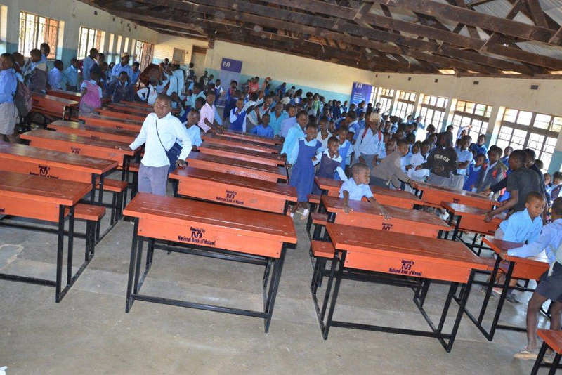 Donation of desks and chairs to Ntejera Community Day Secondary and Limbe Primary Schools