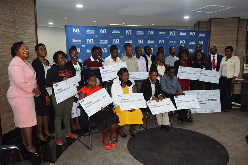NBM officials pose with the students and Polytechnic staff and alumni